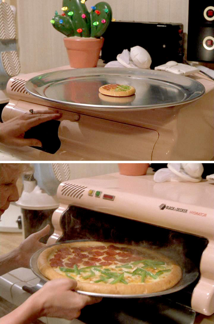 Back to the future. It's 2015, where the is our magic grow pizza?.. she not using mits to grab that ?