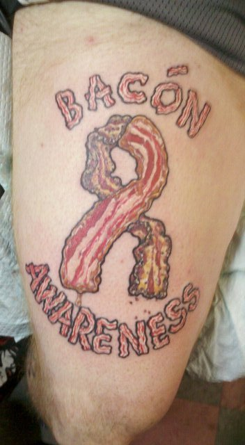 Bacon Awareness. Tattoo my friend recently got. Half peppered, half maple bacon. It's 100% real, he dropped trow right in front of me and the needle marks were