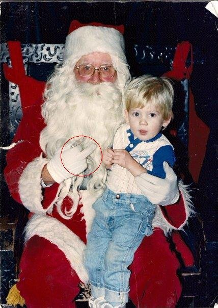Bad Santa. That was when i was three. My parents just showed me the pic today. LOL.