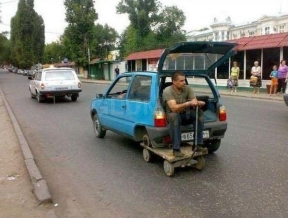 Ghetto Tire Replacement. When you don't have a spare tire around, just think of the next best thing. These guys got it right!.. i think it might fail its MOT