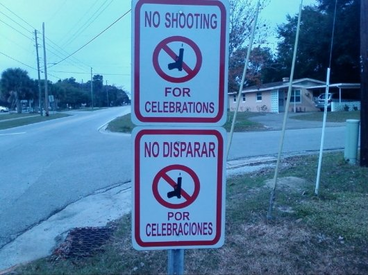 Ghetto street signs. . FDR CELEBRATIONS