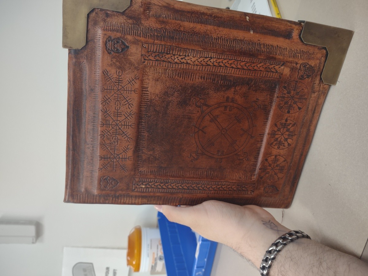 Grimoire outside. I built this grimoire by hand. The only thing I didn't do myself were the pages I bought some coffee stained pages off of Etsy. It's not perfe