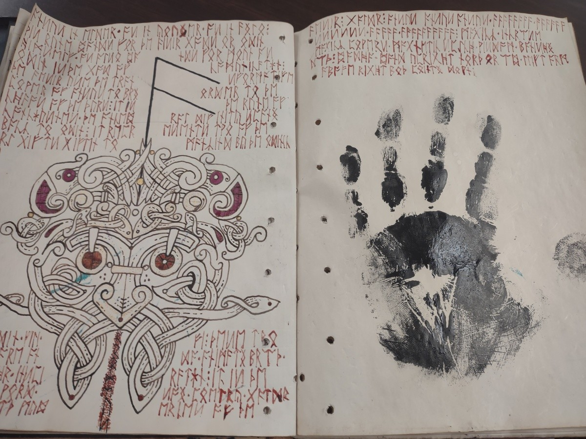 Grimoire. I thought I would show this to y'all. I'm working on a Norse pagan grimoire and this is a rune page for anzus I wrote in my blood and covered the eyes
