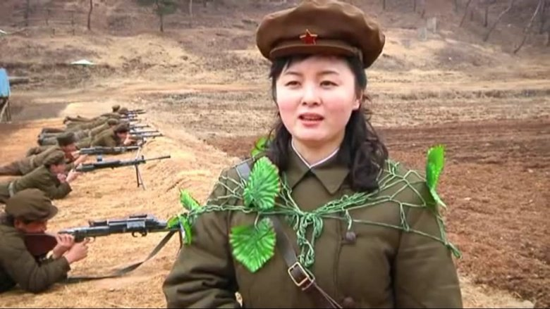 North Korean camo. war is hell, i hope she leaves... I don't get it, all I see are a bunch of rifles and dirt. What's this have to do with North Korea?
