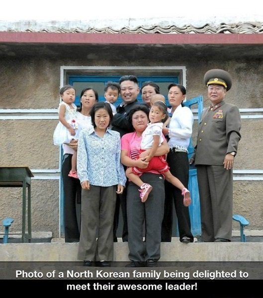 North Korean Famiry. . Photo of a North Korean family being delighted to meet their awesome leader!. He's the only one that doesn't look terrified. Even his general looks uncomfortable.