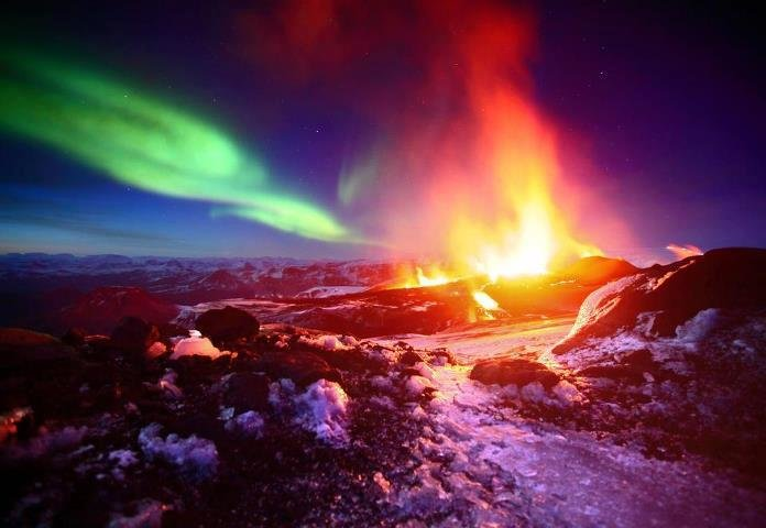 Northern lights over an erupting volcano. .. Do all these individual pictures really need their own post?