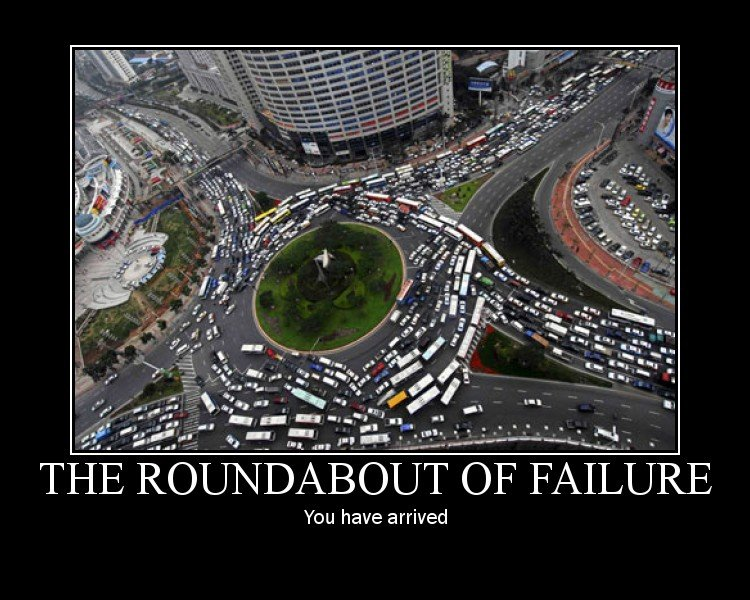 Roundabout of Failure. Fail. You have arrived. sad part is these where designed to not cause traffic jams. such fail.